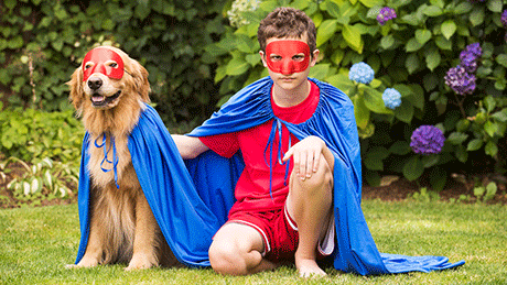 Dog and boy in matching Halloween costumes.